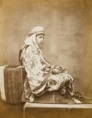 Femme de Constantine portant un caftan en brocart fleuri, circa 1857.